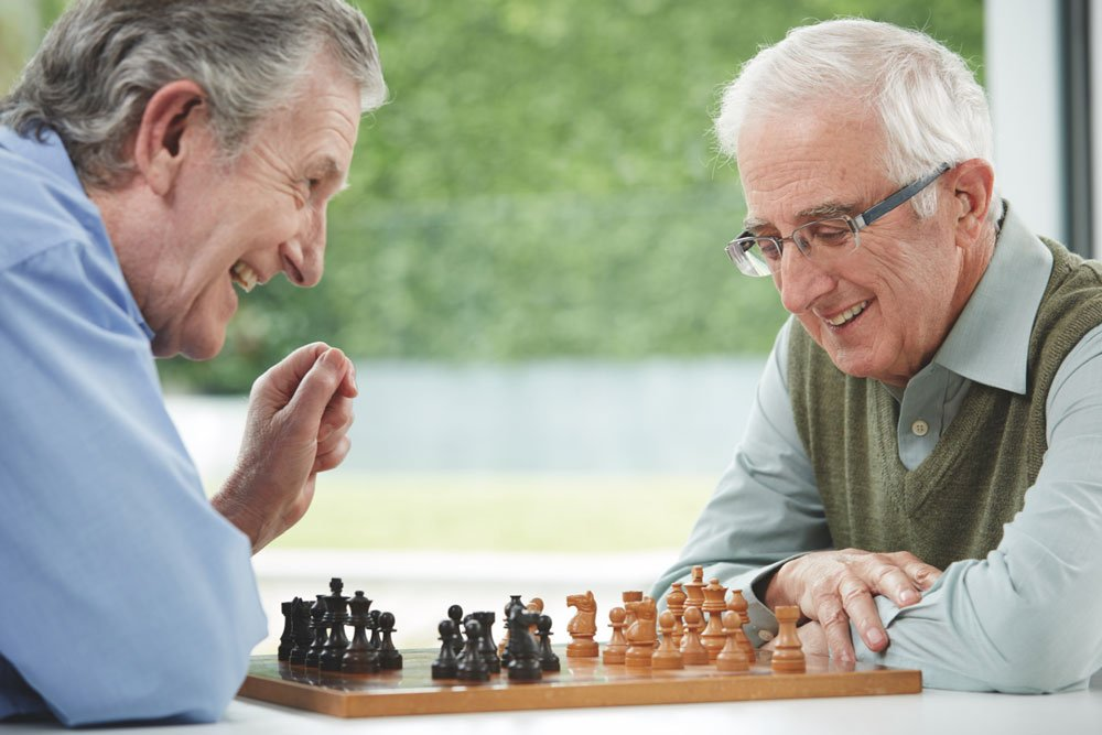Two senior men playing chess, The Orchards
