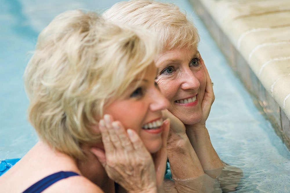 Two senior women in swimming pool at The Orchards