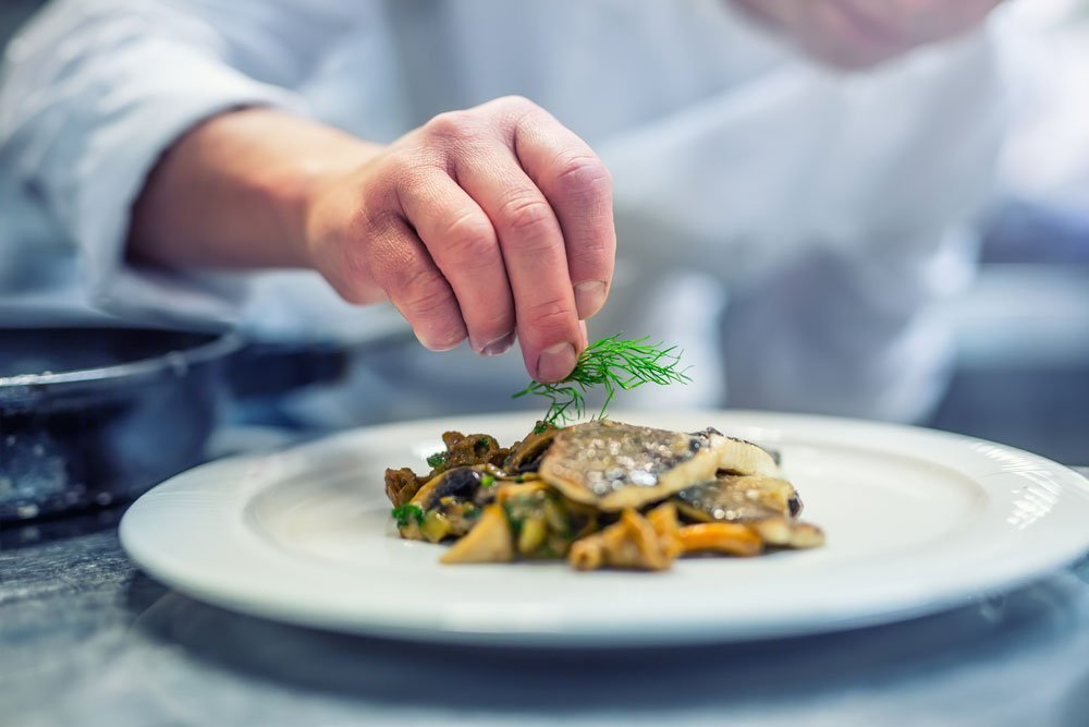 Chef plating a meal, The Orchards